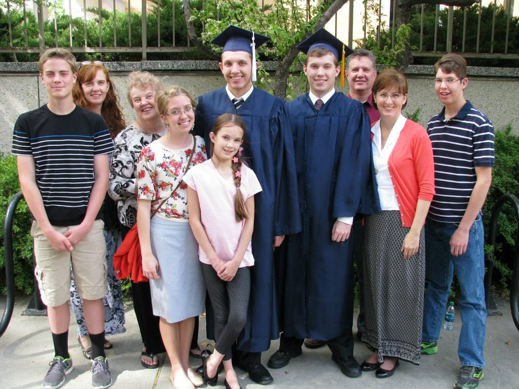 Family picture at two sons' college graduation, both having been mostly homeschooled