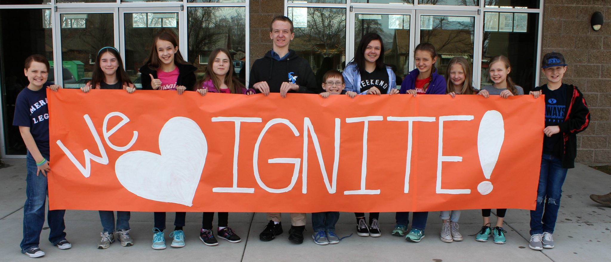 Students holding a sign that says We Love Ignite!