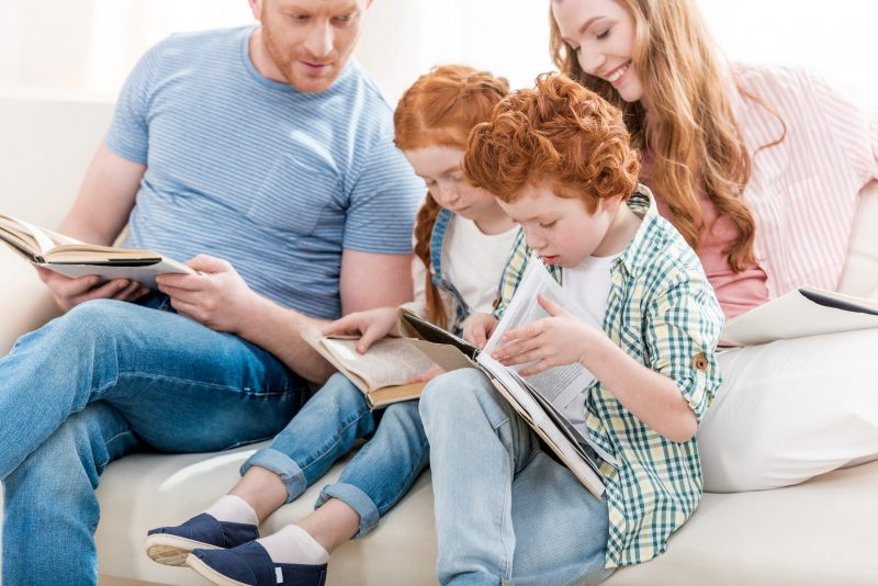 homeschooling family reading together