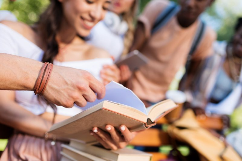 teens studying in the park