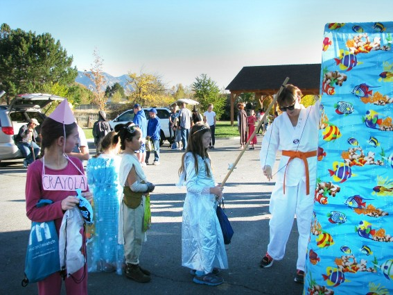 Kids having a blast at a fishing booth at a Halloween Healthy Trunk or Treat