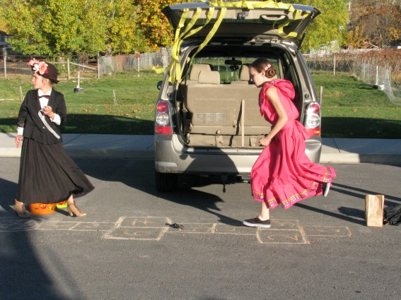 kids doing hopscotch at a Halloween party