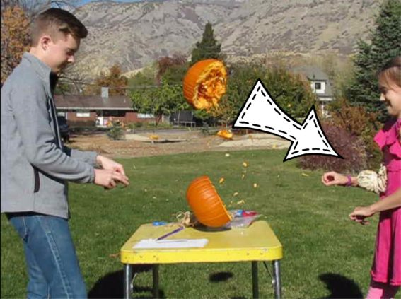 pumpkin exploding in half from pressure of rubber bands on it