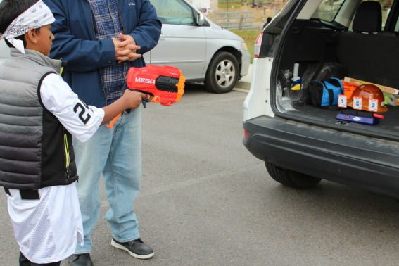 kids shooting nerf guns at a Halloween healthy trunk or treat