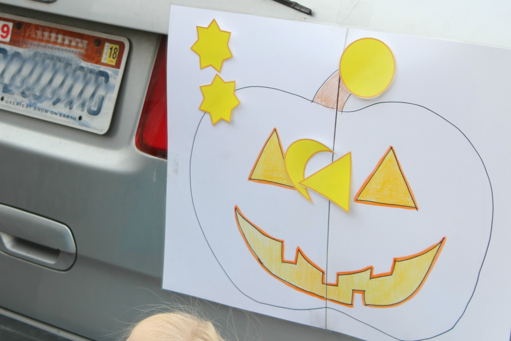 pin the nose on the jack-o-lantern at a Halloween healthy trunk or treat party