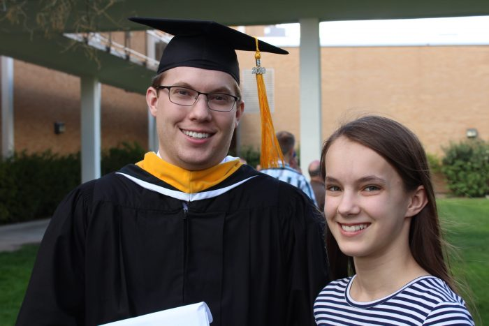 college graduate with his sister